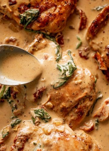 Creamy Tuscan Chicken Thighs drizzle with the best cream sauce!