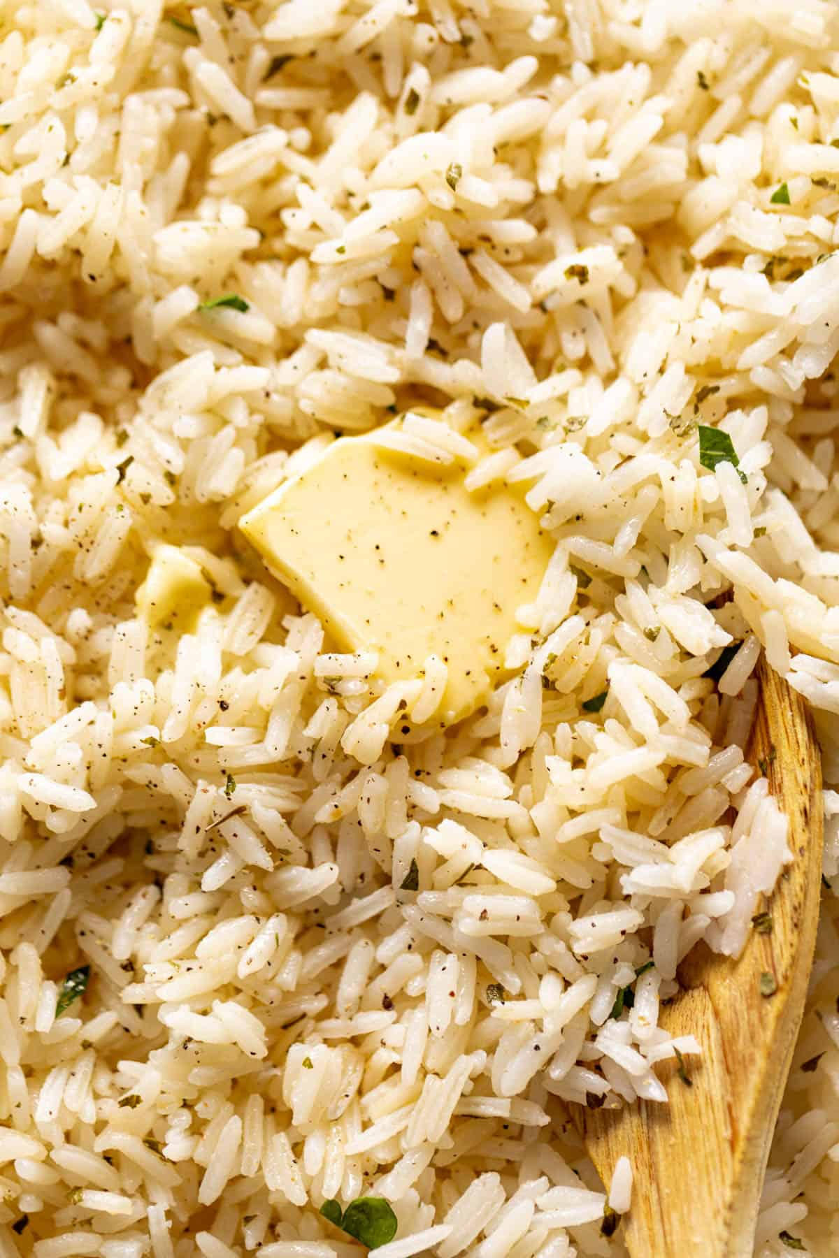 Garlic Butter Rice served with melted butter and cracked black pepper | craveitall.com